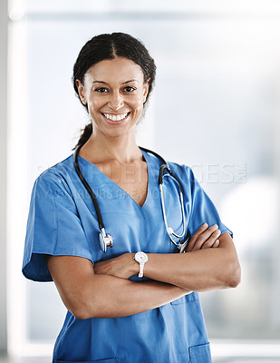 Buy stock photo Shot of a confident young doctor working in a hospital
