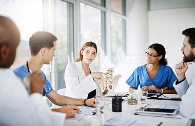 Buy stock photo Cropped shot of a team of doctors having a meeting