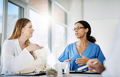 Buy stock photo Cropped shot of two medical practitioners having a discussion