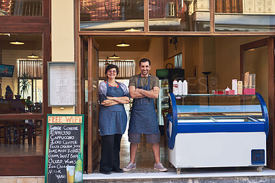 Buy stock photo Full length portrait of a mature woman and her adult son standing in the entrance way to their family ice cream shop
