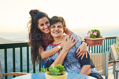 Buy stock photo Cropped portrait of an attractive young woman spending quality time with her mother