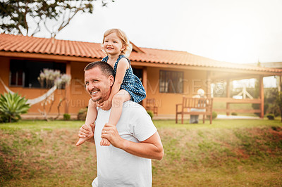 Buy stock photo Cropped shot of a mature man carrying his young daughter on his shoulders outside