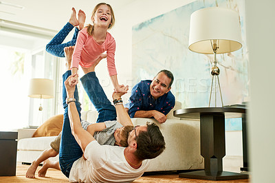 Buy stock photo Cropped shot of an adorable little girl playing with her father at home