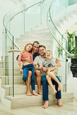 Buy stock photo Full length portrait of an affectionate family of four on the stairs at home