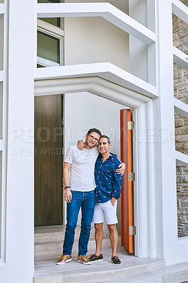 Buy stock photo Full length portrait of an affectionate mature couple standing in the doorway to their home