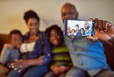 Buy stock photo Cropped shot of a happy family taking a selfie at home