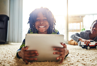 Buy stock photo Shot of a young boy using a digital tablet