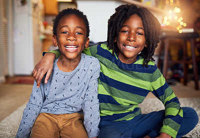 Buy stock photo Cropped shot of two adorable little boys sitting together