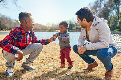 Buy stock photo Shot of a father and his two little sons bonding together outdoors