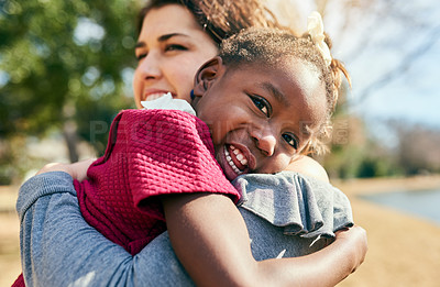 Buy stock photo Portrait of an adorable little girl hugging her mother outdoors