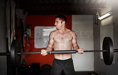 Buy stock photo Cropped shot of a handsome and muscular young man working out with a barbell in the gym