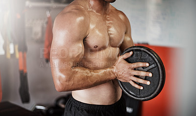 Buy stock photo Cropped shot of an unrecognizable muscular young man working out with a weight in the gym