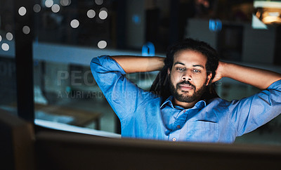 Buy stock photo Shot of a young designer taking a break while working late in an office