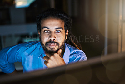 Buy stock photo Portrait of a young designer working late in an office