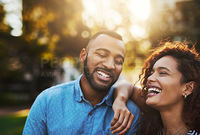 Buy stock photo Shot of a happy young couple enjoying a day in the park