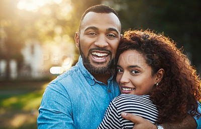Buy stock photo Portrait of a happy young couple embracing in the park