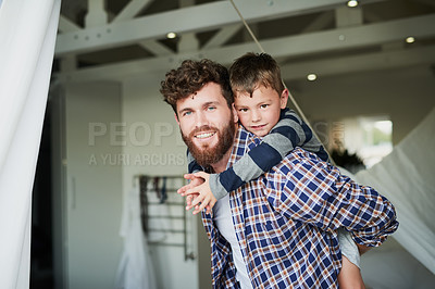 Buy stock photo Cropped portrait of a handsome young man carrying his son on his back