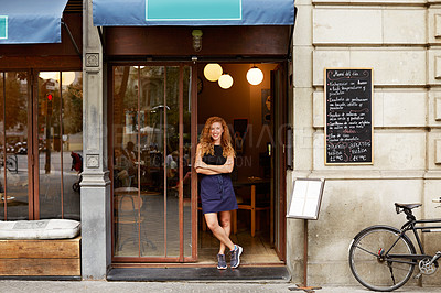 Buy stock photo Shot of a coffeeshop owner standing in the doorway of her business