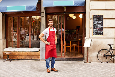 Buy stock photo Shot of a young man standing in front of his coffee shop