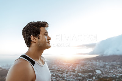 Buy stock photo Cropped shot of a handsome young man taking in the views while running in the mountains