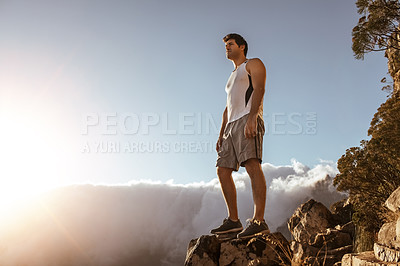 Buy stock photo Full length shot of a handsome young man taking in the views while running in the mountains