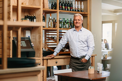 Buy stock photo Cropped portrait of a mature male entrepreneur standing in his self-owned coffee shop