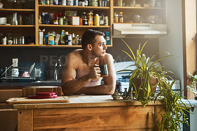 Buy stock photo Cropped shot of a handsome young shirtless man drinking a cup of coffee in the kitchen at home