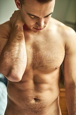Buy stock photo Cropped shot of a young handsome shirtless man in his bedroom at home
