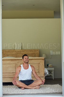 Buy stock photo Shot of a young handsome man practicing yoga at home
