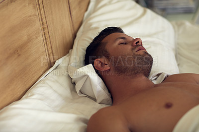 Buy stock photo Cropped shot of young handsome man sleeping in bed at home