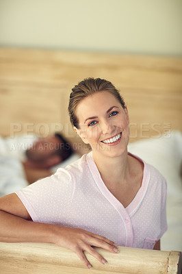 Buy stock photo Portrait of young attractive woman while her husband is lying in bed at home