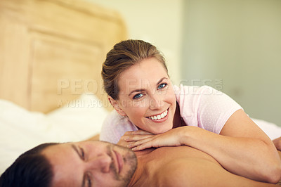 Buy stock photo Cropped shot of a young attractive wife lying on her husband's chest in bed at home