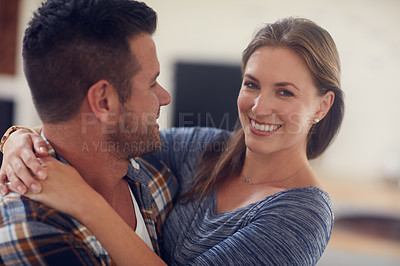 Buy stock photo Cropped shot of a young married couple spending the day at home