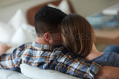 Buy stock photo Rearview shot of an unrecognizable married couple spending the day at home