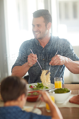 Buy stock photo Cropped shot of a man enjoying a meal at home