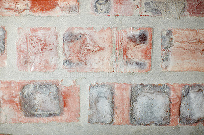 Buy stock photo Cropped shot of a weathered facebrick wall