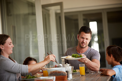 Buy stock photo Cropped shot of a family of four sitting down for a meal at home