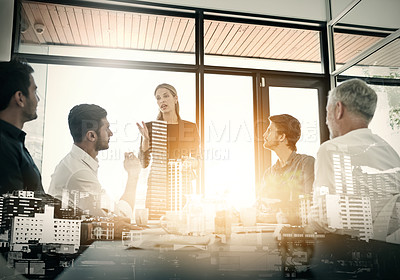 Buy stock photo Cropped shot of a businesswoman talking to her colleagues during a meeting in an boardroom superimposed over a city background
