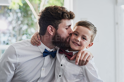 Buy stock photo Portrait of an adorable little boy and his father dressed in matching outfits at home