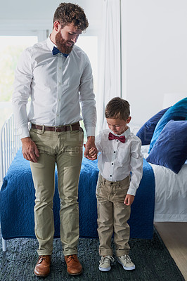 Buy stock photo Shot of an adorable little boy and his father dressed in matching outfits