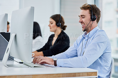 Buy stock photo Shot of a team of young people working in a call center
