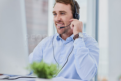 Buy stock photo Shot of a confident young man working in a call center