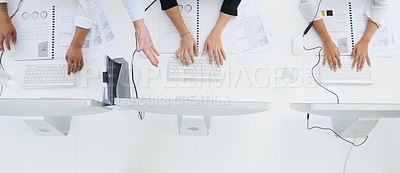 Buy stock photo Cropped shot of unrecognizable businesspeople using their computers in a modern office