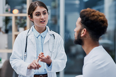 Buy stock photo Shot of a young doctor having a consultation with a patient in her office