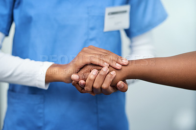 Buy stock photo Closeup shot of a nurse holding a patient's hand in comfort