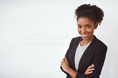 Buy stock photo Studio shot of a confident young businesswoman posing against a gray background