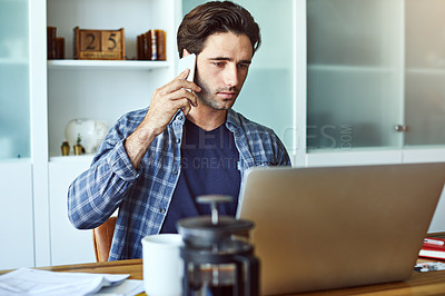 Buy stock photo Cropped shot of a handsome young man on a call while working from home