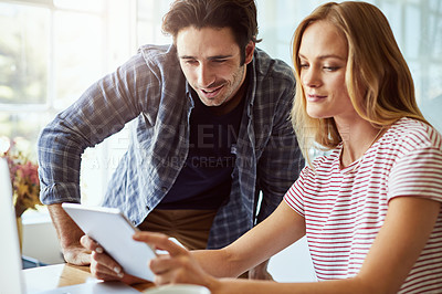 Buy stock photo Cropped shot of a young attractive couple using a tablet together at home