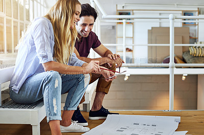 Buy stock photo Shot of a young couple working on their home together