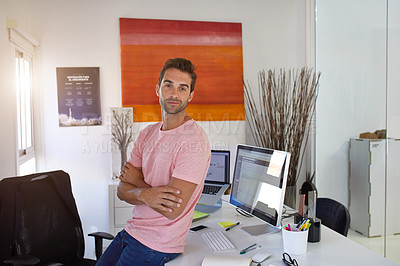 Buy stock photo Shot of a handsome young man in his office